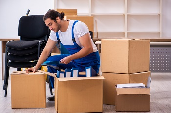 Young male professional local mover doing home relocation